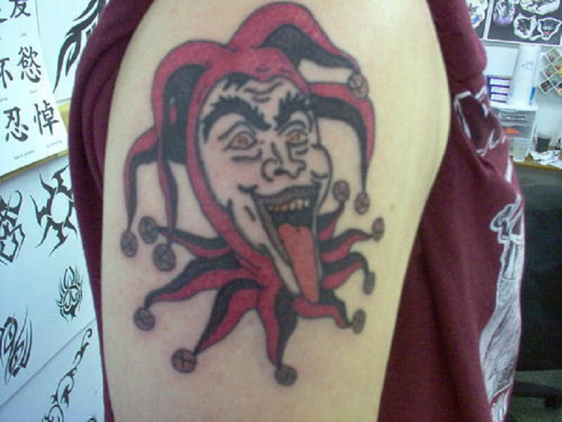 Creepy Jester Arm Tattoo