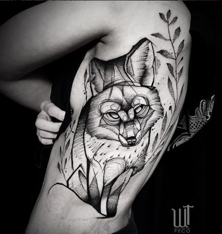 black and grey fox tattoo on rib cage