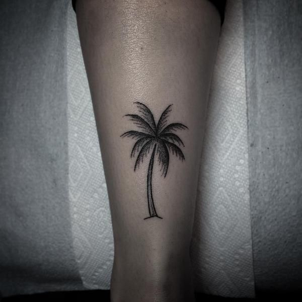 Amazing-Palm-Tree-Tattoo-On-Girl-Back-Leg