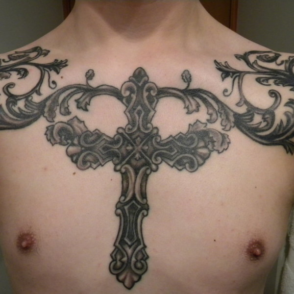 Cross tattoo men chest 3