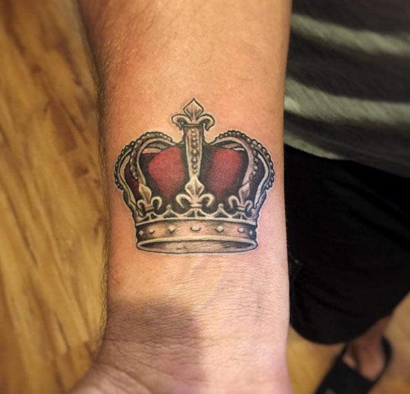 Crown Colored Wrist Tattoo