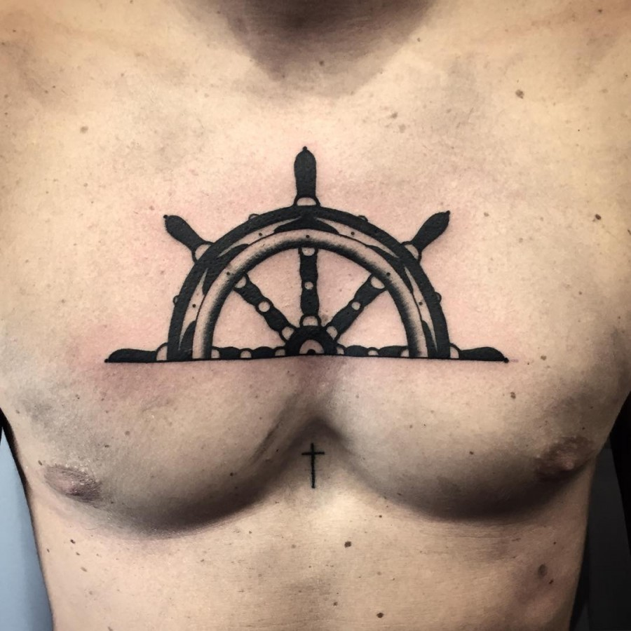Helm half chest tattoo