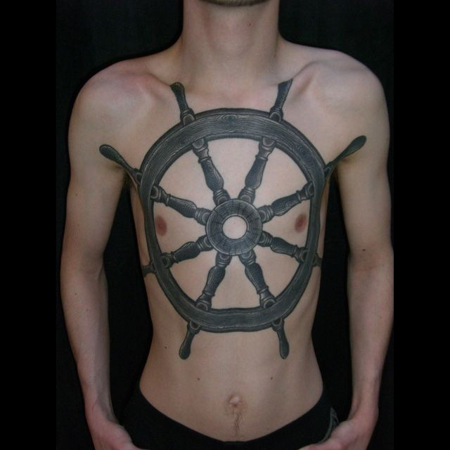 Helm large chest tattoo