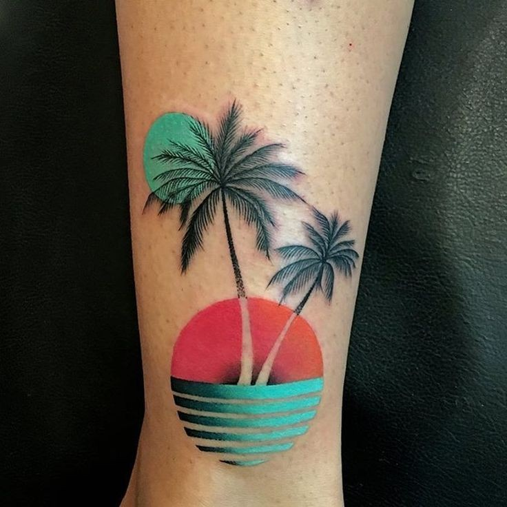 colorful sunset palm tree leg tattoo