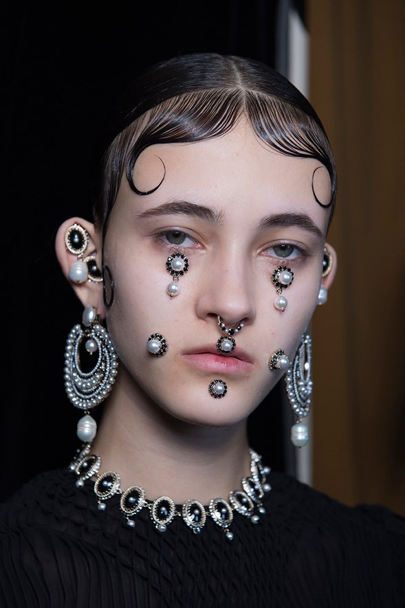 face jewelry and a septum piercing