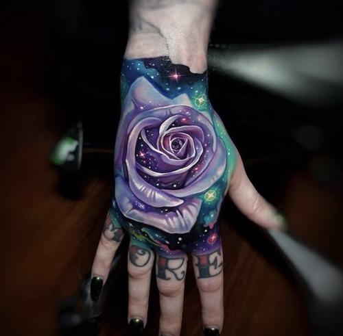 galaxy flower hand tattoo