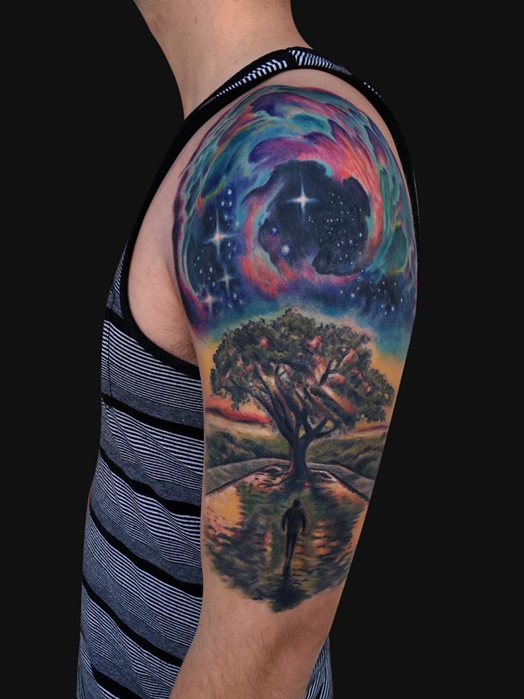 galaxy from earth sleeve tattoo