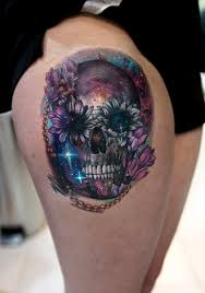 galaxy skull knee tattoo
