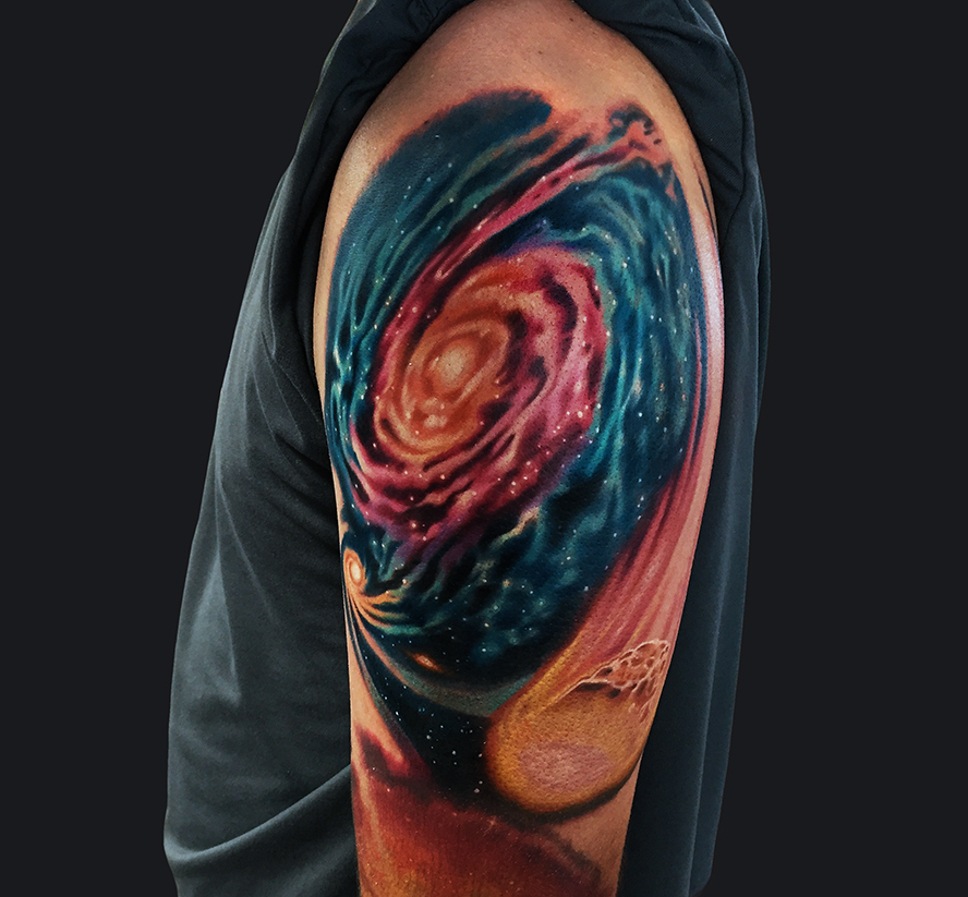 galaxy swirl sleeve tattoo