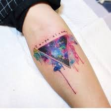 galaxy triangle watercolor arm tattoo