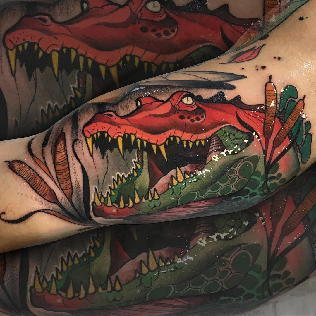 neo crocodile arm tattoo