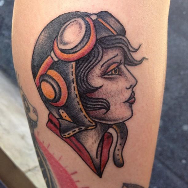neo girl aviator leg tattoo