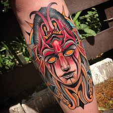 neo mask arm tattoo