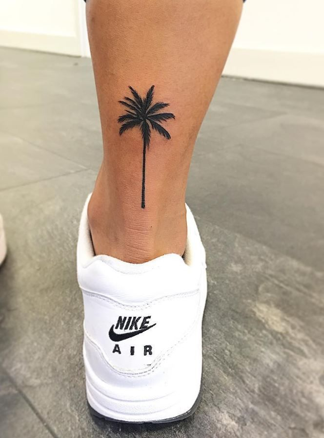 palm tree back leg tattoo