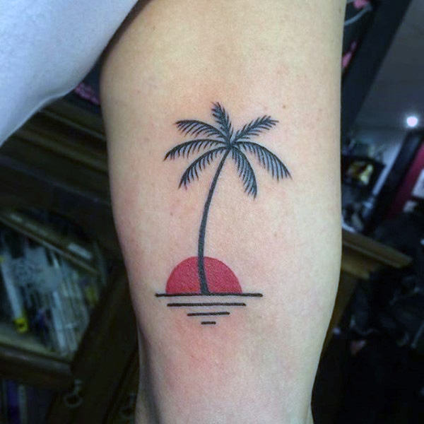 palm tree sunset arm tattoo