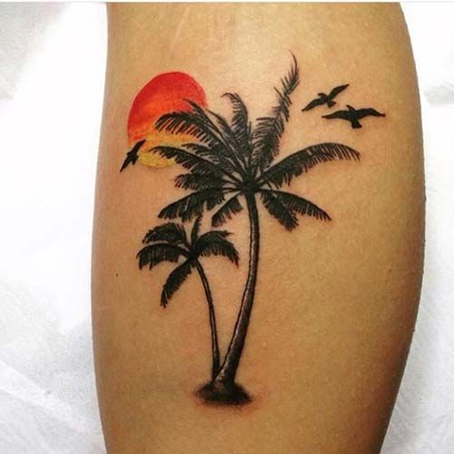 palm tree sunset leg tattoo