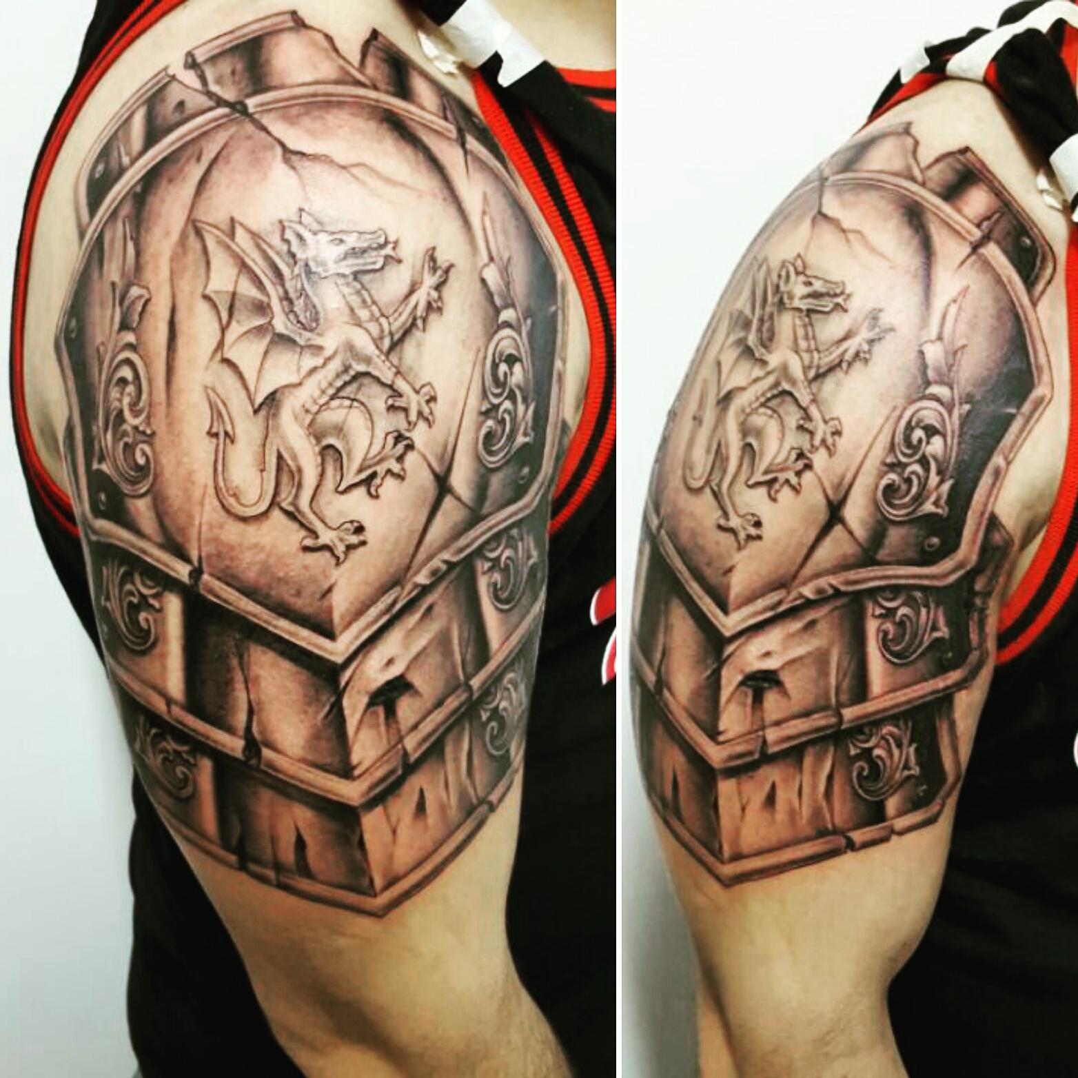 shoulderplate dragon tattoo
