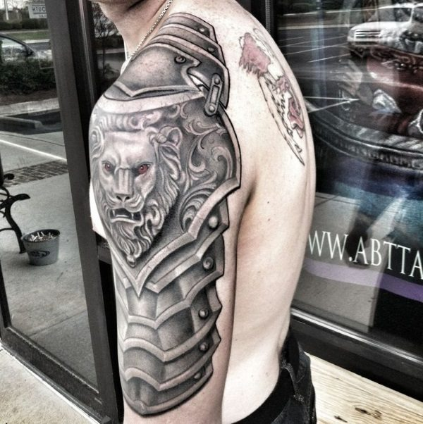 shoulderplate lion tattoo