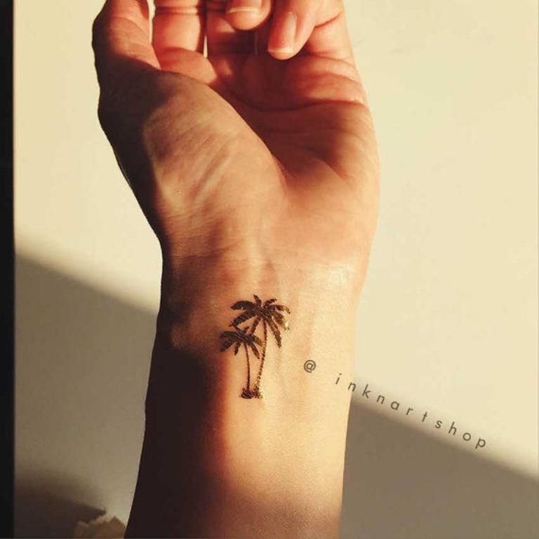 small palm tree wrist tattoo