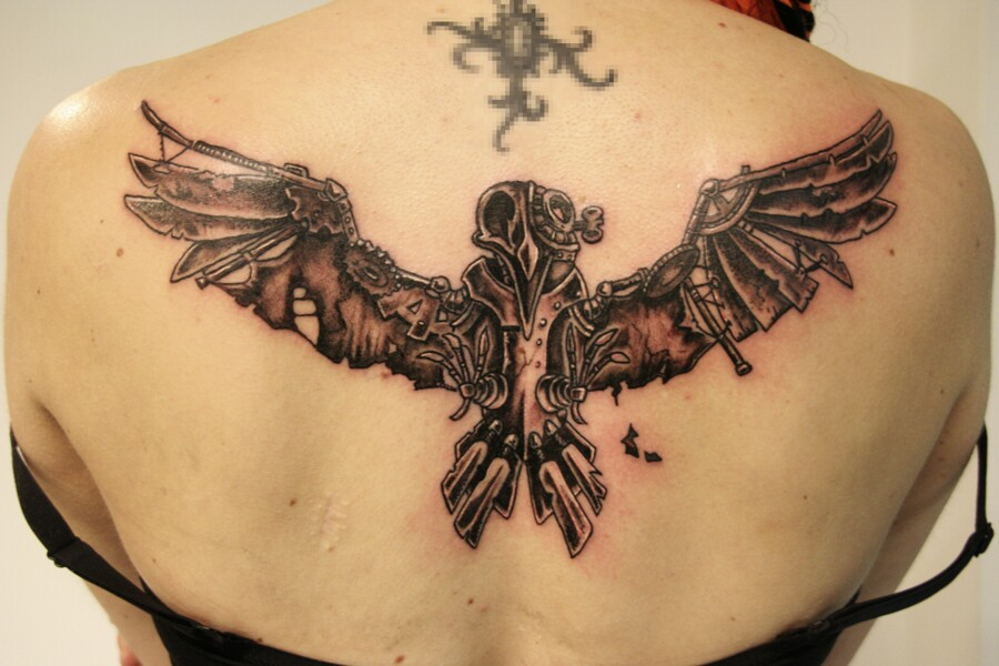 steampunk bird back tattoo
