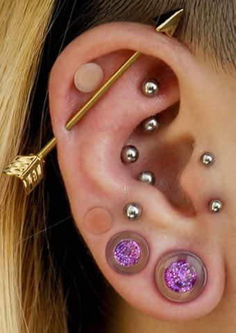 two tragus piercings