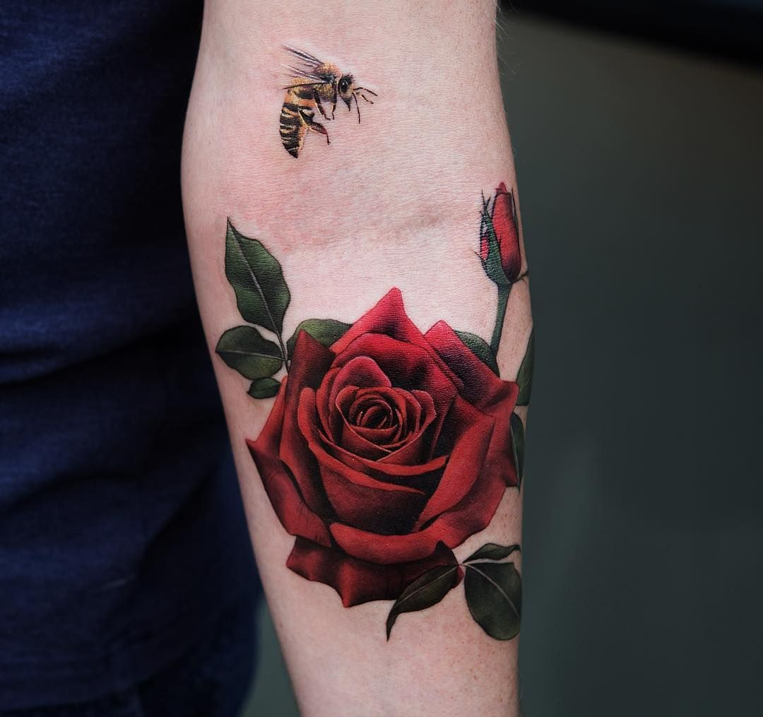 Red rose tattoo arm 1