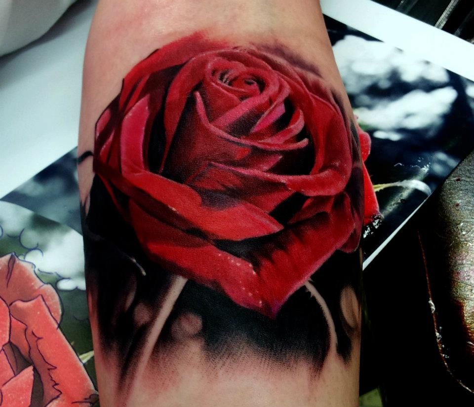 Red rose tattoo leg 1