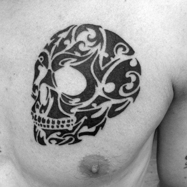 tribal skull tattoo chest 1