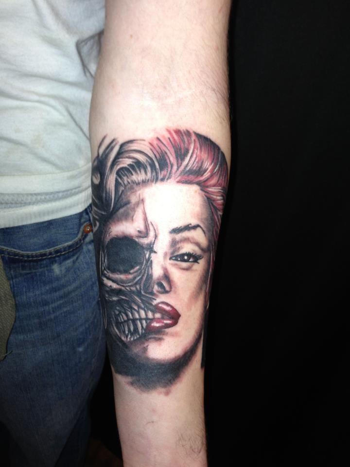 women skull tattoo arm 1