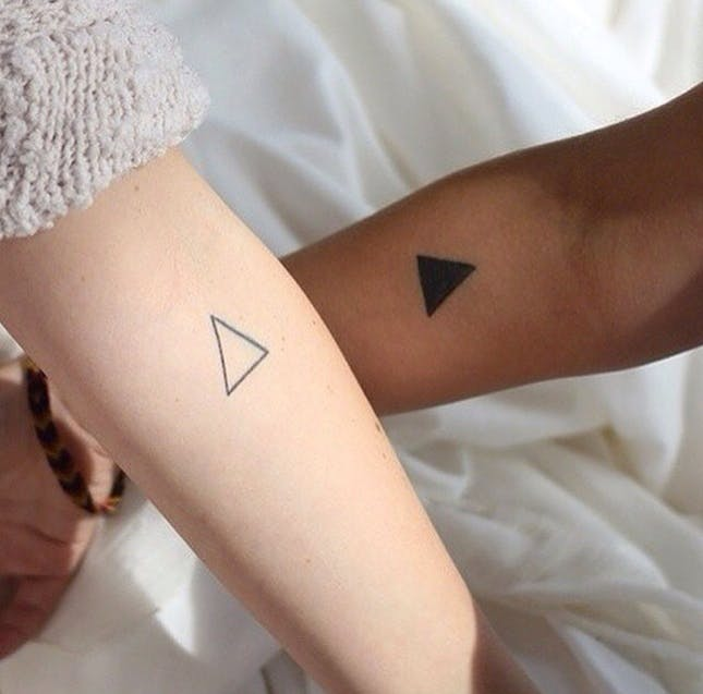 simple geometric tattoo arm 2