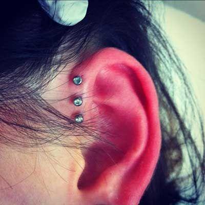 triple anti helix piercing