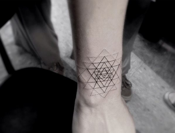 women geometric tattoo ankle 2