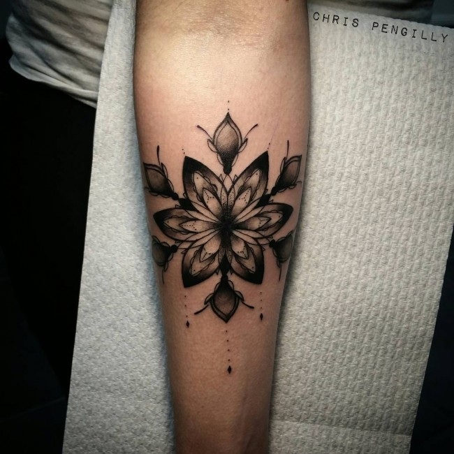 forearm mandala inspired tattoo