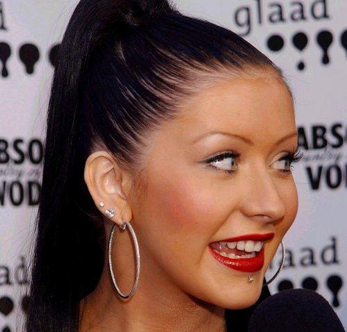 christina aguilera lip piercing