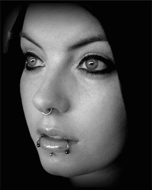 lip and snake bite piercings