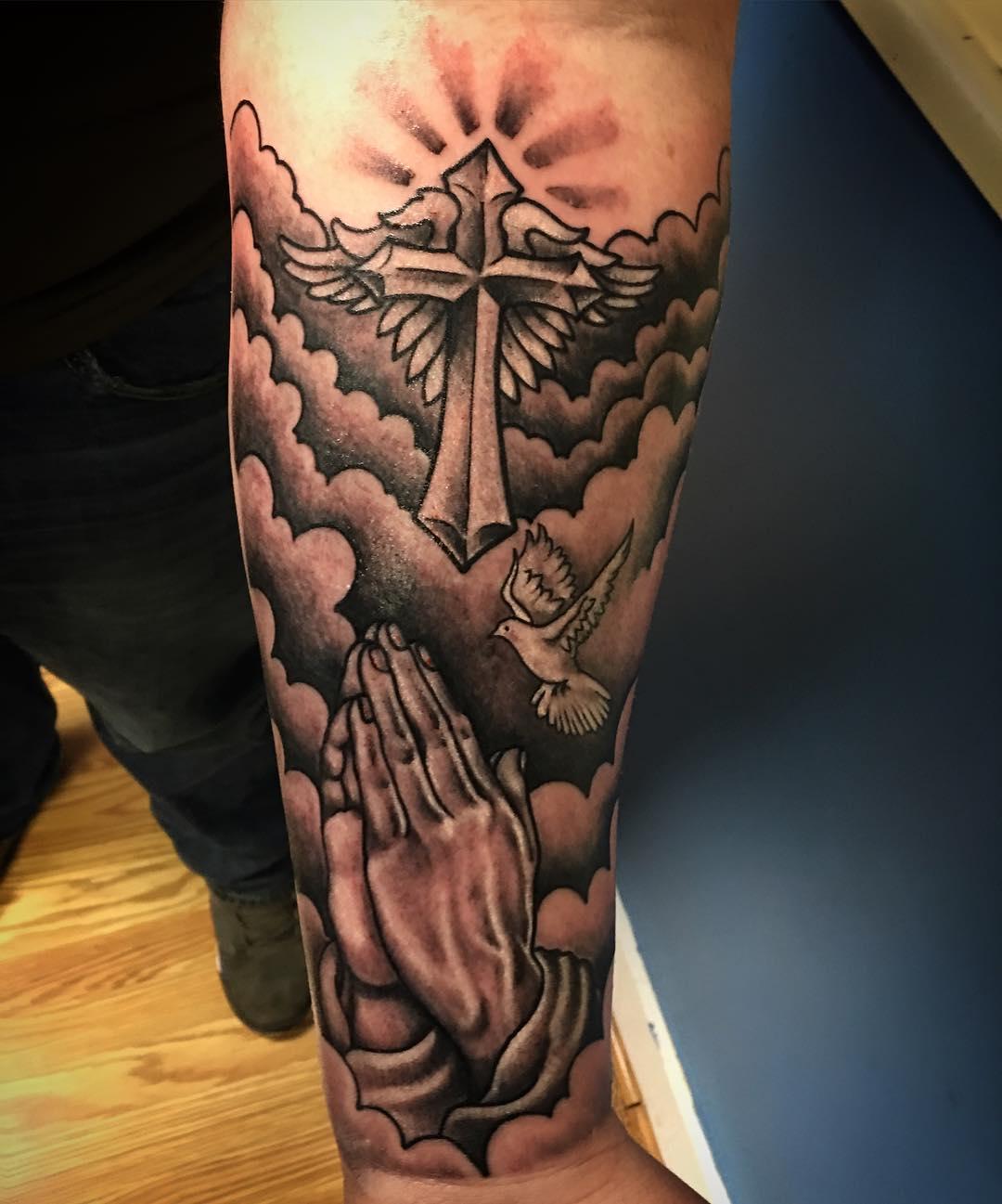 praying hands tattoo dove