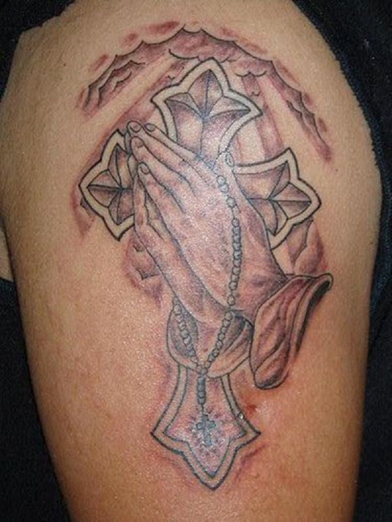 praying hands tattoo cross