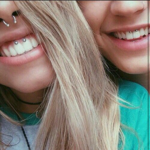 septum and smiley piercings