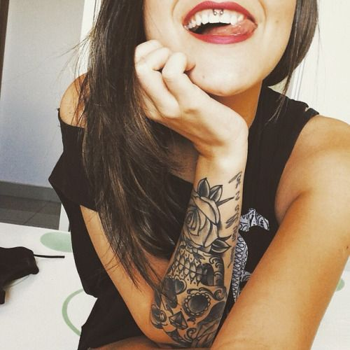 tattoos and smiley piercing