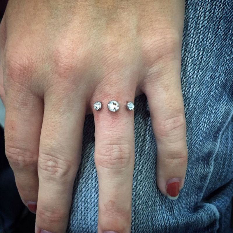 Dermal piercing on finger