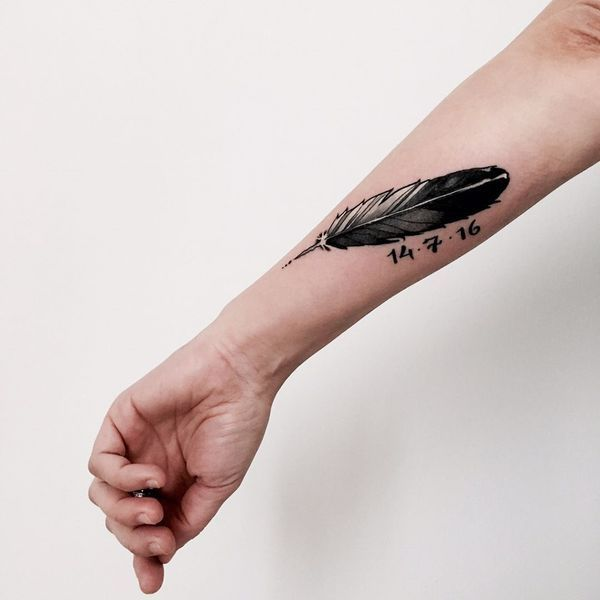 feather tattoo with date