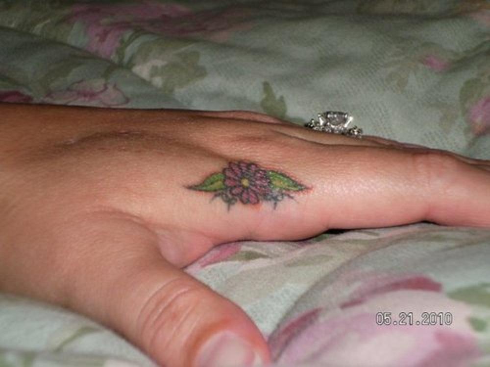 finger tattoo flower