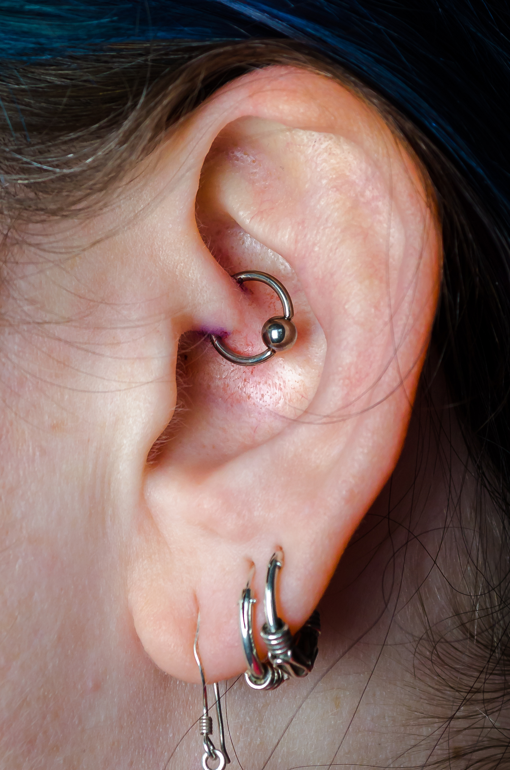 daith and earlobe piercings
