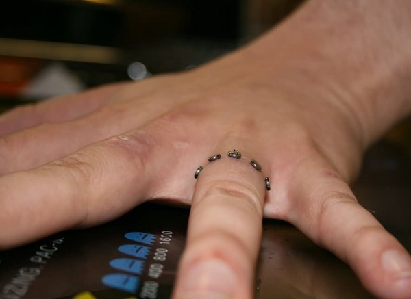dermal piercing as engagement ring