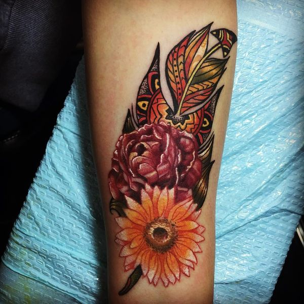 feather tattoo with flower