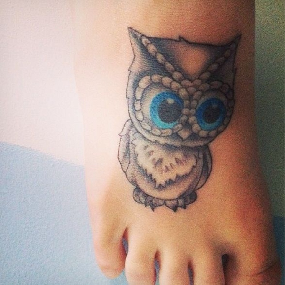 owl tattoo big eyes