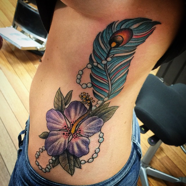 flower and feather tattoo
