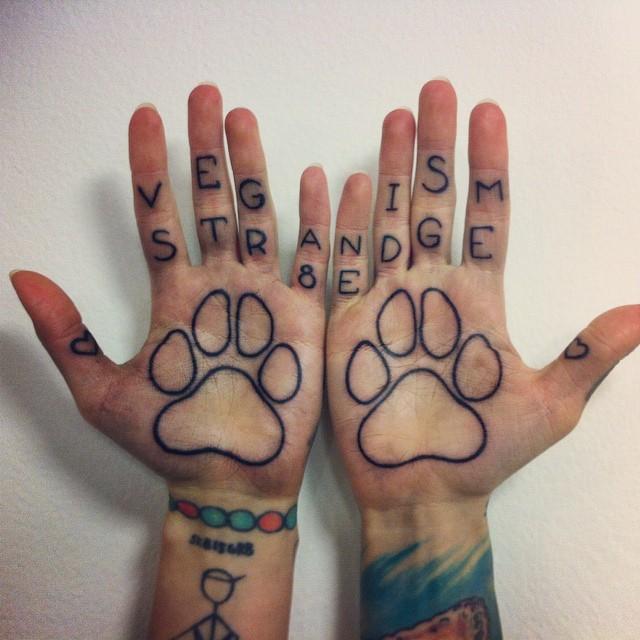 paw print hand tattoo women