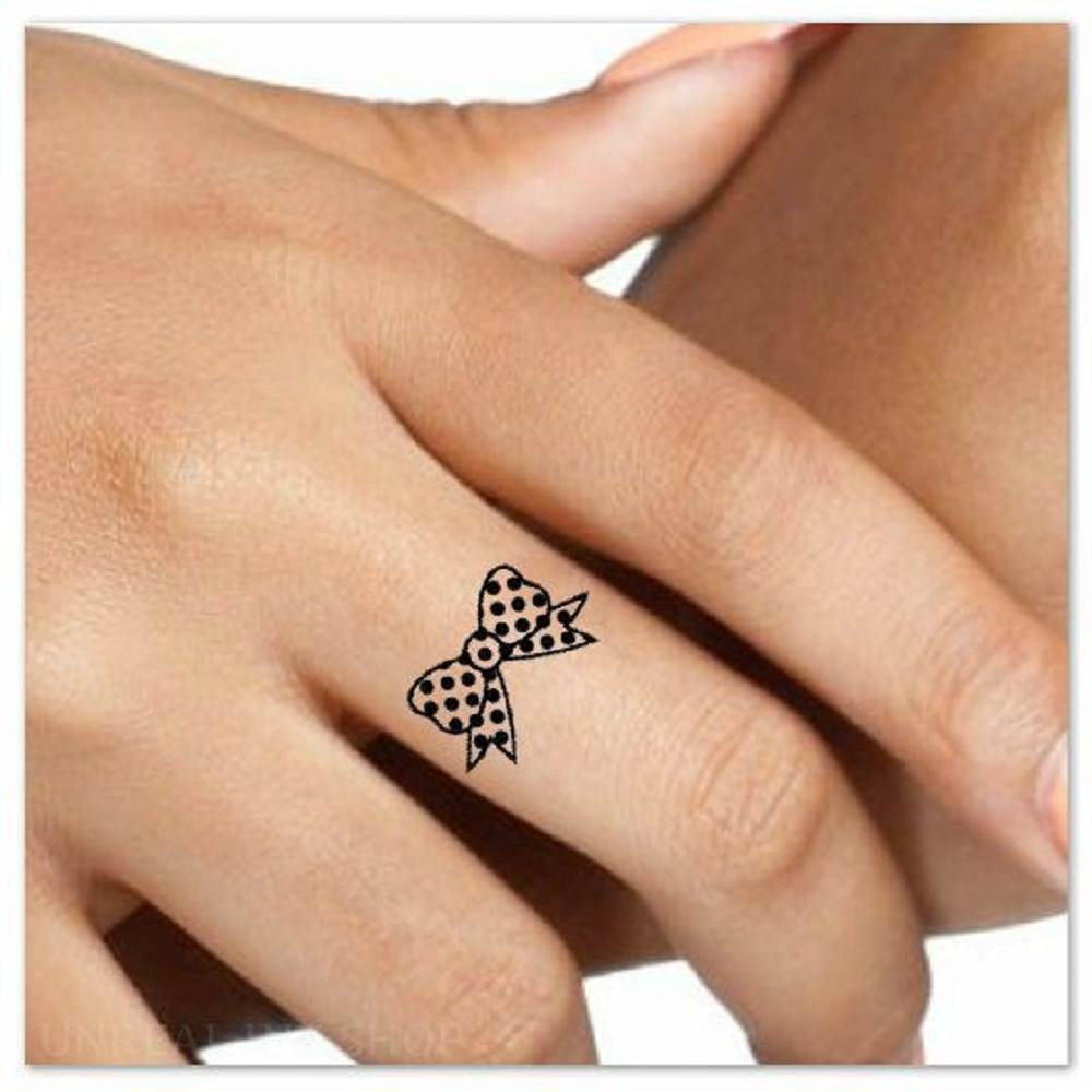 finger tattoo women