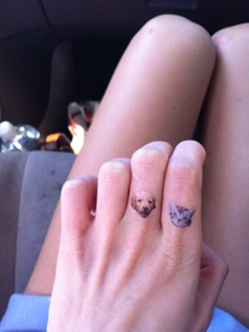 finger tattoo cat